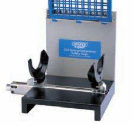 Cage for compressor shock absorber
